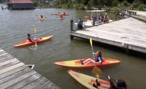 Students in kayaks on a Friends of the Rappahannock field trip